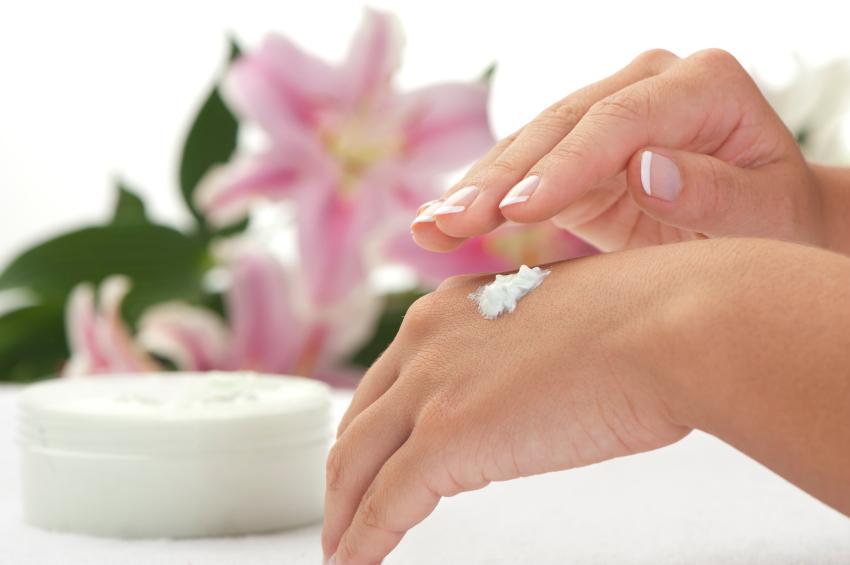 Woman applying moisturiser to her hand