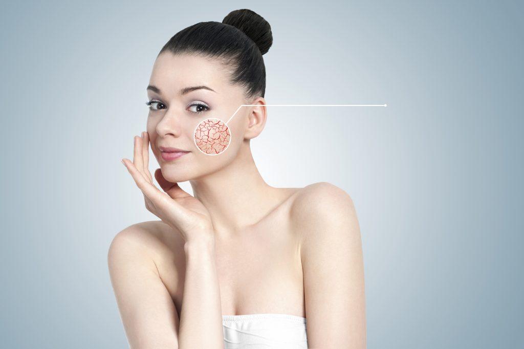 Beautiful young brunette woman portrait - skin care concept
